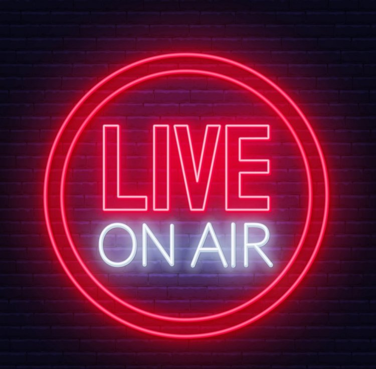 Live on air glowing neon sign on brick wall background.
